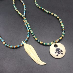 Handmade OOAK Carved Feather & Skull Necklaces!